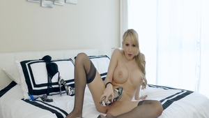 Katie Banks in tight stockings playing with toys
