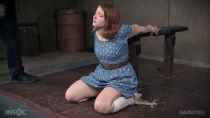 Young redhead extreme tied up