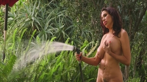 Shaved busty granny Lisa Marie fingering outdoors