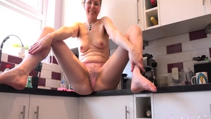 Amazing housewife masturbation in the kitchen
