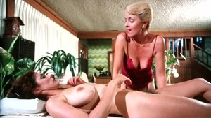 Kay Parker together with Ron Jeremy sucking cock
